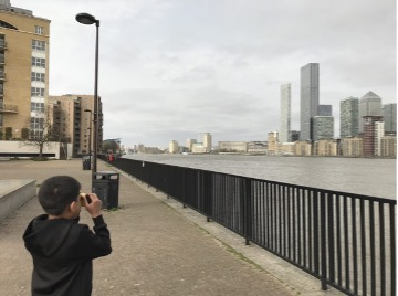 boy by the river thames